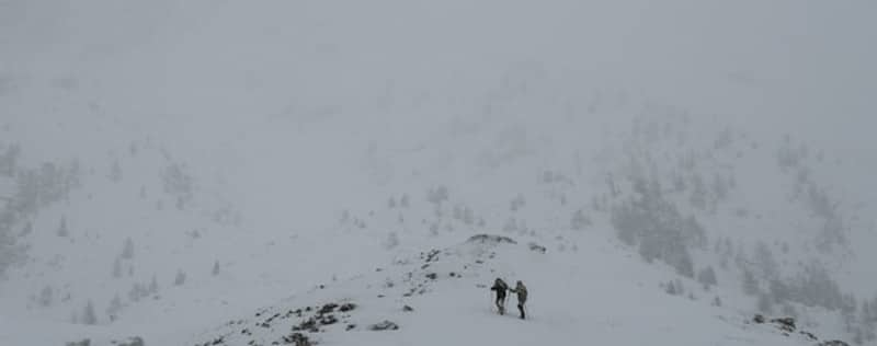 climbing a mountain enduring the weather